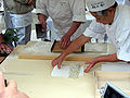 Preparing Soba 12 wrapping a batch.jpg