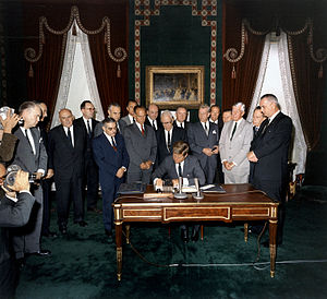 President Kennedy signs Nuclear Test Ban Treaty, 07 October 1963