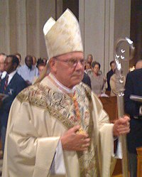 Procession - His Eminence William Cardinal Levada (cropped).jpg