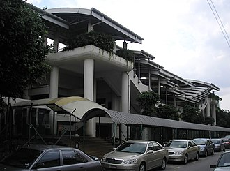 Pudu LRT station - An exterior view of the Pudu station, as seen from Jalan Sarawak to the northwest, illustrates the station design's consistency with other elevated Ampang Line and Sri Petaling Line stations.