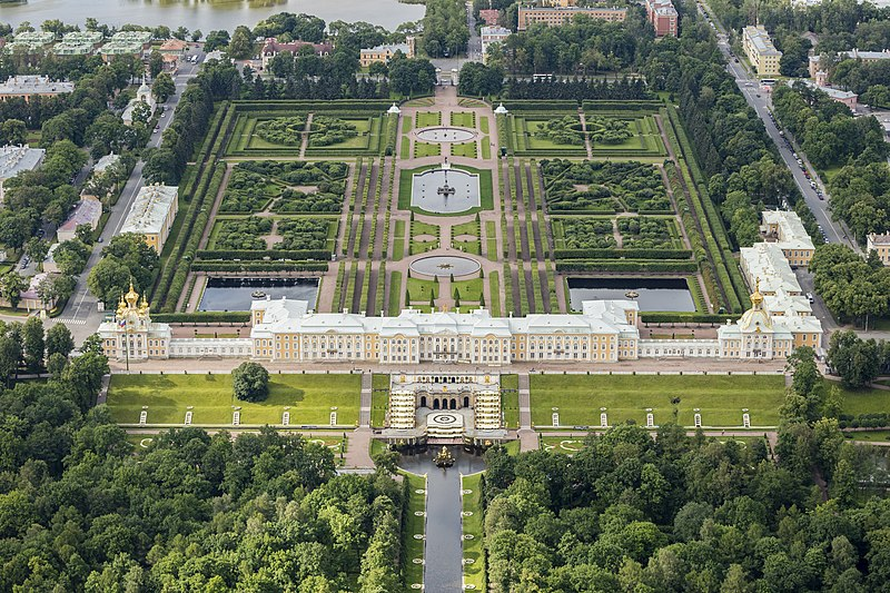 """Aerial photo of Peterhof Palace, in Petergof, Saint Petersburg, Russia. Initiated by Peter the Great, the grounds are sometimes referred as the """"Russian Versailles""""."""