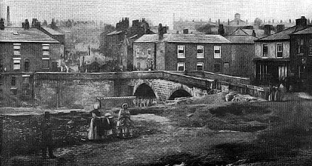 The earliest known photograph of Radcliffe Bridge district, taken by William Smith in 1854. The belfry of the original St Thomas' Church is visible on the horizon. Radcliffe Bridge.jpg