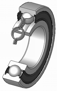 Rolling-element bearing bearing which carries a load by placing rolling elements (such as balls, rollers) between two bearing rings called races. The relative motion of the races causes the rolling elements to roll with very little rolling resistance and with little sliding
