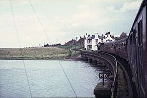 The St. Andrews Railway - Railtour train crossing the estuary of the River Eden in 1965