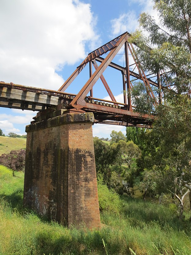Railway bridge abutment riverbank park yass.JPG