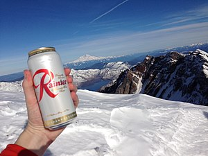 Rainier Brewing Company - Rainier Beer on Washington State's Mt. Saint Helens with Mount Rainier in the background