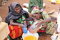 Receiving monthly WFP food rations (10716822213).jpg