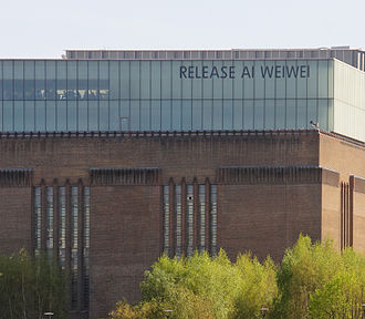 "Ai Weiwei - Tate Modern in London, home to Ai's 'Sunflower Seeds' exhibition, put a large sign on their exterior that read ""Release Ai Weiwei"""