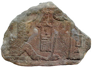 Sanakht - Relief fragment of Sanakht in the pose of smiting an enemy. Originally from the Sinai, now EA 691 on display at the British Museum.