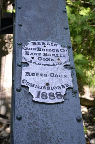 Ruhle Road Lenticular Metal Truss Bridge - The plaque bolted to the bridge showing its origin.