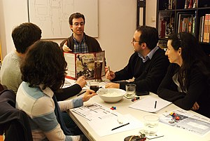 Gamemaster - A Gamemaster explaining to the players in a table-top RPG