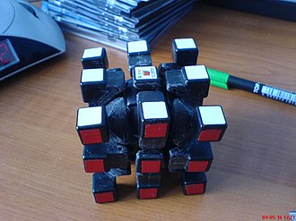 V-Cube 7 - An original Professor's Cube with many of the pieces removed shows the 3×3×3 equivalence of the remaining pieces. The same principle applies to the V-Cube 7.