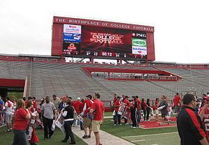High Point Solutions Stadium - The newly expanded South End zone at Rutgers Stadium, pictured after the 2010 spring game. Note the Brown Football Recruiting Pavilion and Welcome Center located in the center of the seating area, as well as the brand new scoreboard.