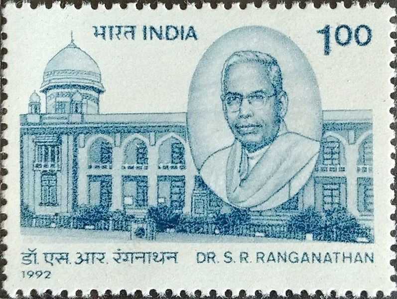 Postage Stamp from India in Blue Ink of a building, the National Library of India, with an oval portrait of Dr. S.R. Ranganathan. 1992. 100 rupees.