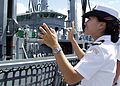 Sailor waving to South Korean ship.jpg