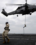 Sailors practice fast rope techniques abord USS Harry S. Truman DVIDS90873.jpg
