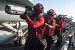 Sailors prepare to load ordnance onto an F-A-18E Super Hornet on the flight deck of USS Dwight D. Eisenhower. (27903506941).jpg