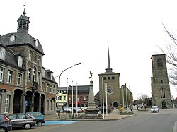 Saint-Ghislain: the former town hall (1752), the new church, and the tower of the old church (16th century)