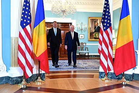 Romania is a noteworthy ally of the United States, being the first NATO member state that agreed to support increasing its defence spending after the 2017 Trump-Iohannis meeting at the White House. Secretary Tillerson and Romanian President Iohannis Meet Before Reporters in Washington (34356507264).jpg