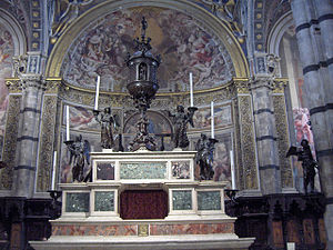 Francesco di Giorgio Martini - Altar at the Opera del Duomo in Siena. The angel candelabras are the work of Francesco di Giorgio.