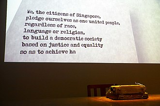 "Nominated Member of Parliament - An animated display at the National Museum of Singapore featuring a portion of the Singapore National Pledge. When reciting it, Singapore citizens pledge themselves ""as one united people, regardless of race, language or religion""."
