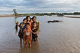 Six children in the Mekong with buffalos and boat.jpg