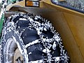 Snow chains on tractor wheel 20180215.jpg