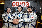 Soyuz MS-01 crew in front of their spacecraft.jpg