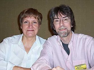 Spider Robinson - Spider Robinson with wife Jeanne Robinson at the 2004 Necronomicon.