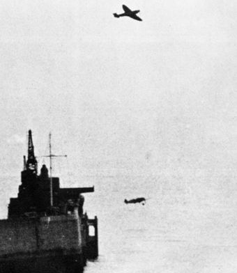 A Spitfire overflies a ditching Bf 109 Spitfire and Me 109 in flight 1940.jpg
