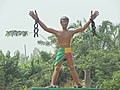 Statue of liberation from slavery at the entrance of Comè city in Benin.jpg