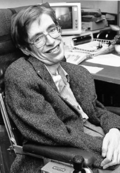 black and white photo o Hawking in a chair, in an office.