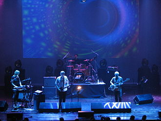 Mike Howlett - Steve Hillage Band (June 19, 2009), from left: Miquette Giraudy (keyboards), Steve Hillage (guitar), Chris Taylor (drums) and Mike Howlett (bass).
