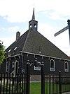 Stolphoevekerkje: Hervormde Kerk. Ongeveer vierkant houten gebouwtje in de vorm van een stelphoeve