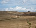 Stubble fields with straw bales, Tuscany.jpg