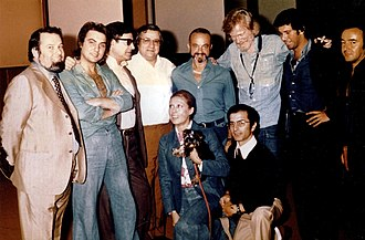Astor Piazzolla - Astor Piazzolla with Gerry Mulligan at the Summit recording, Milan (Italy) 1974. The image includes the producer Aldo Pagani, first from the left, and some performers, including Pino Presti, 2nd from right, and Tullio De Piscopo, 2nd from left