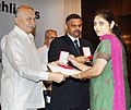 Sushil Kumar Shinde presented the Census Medals, at the release of the Primary Census Abstract- Data Highlights, in New Delhi. The Registrar General and Census Commissioner of India, Dr. C. Chandramouli is also seen.jpg