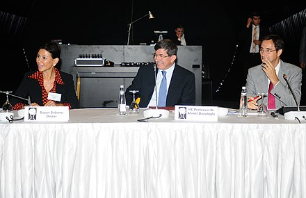 Davutoglu (C) at the Chatham House International Roundtable, Istanbul, September 2012 with Suzan Sabanci Dincer (L) and Dr Robin Niblett (R) Suzan Sabanci Dincer, Ahmet Davutoglu, and Dr Robin Niblett (7999218930).jpg