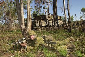 1st Brigade (Australia) - A soldier of the 5/7th Battalion, The Royal Australian Regiment, conducts fire and movement during training here.