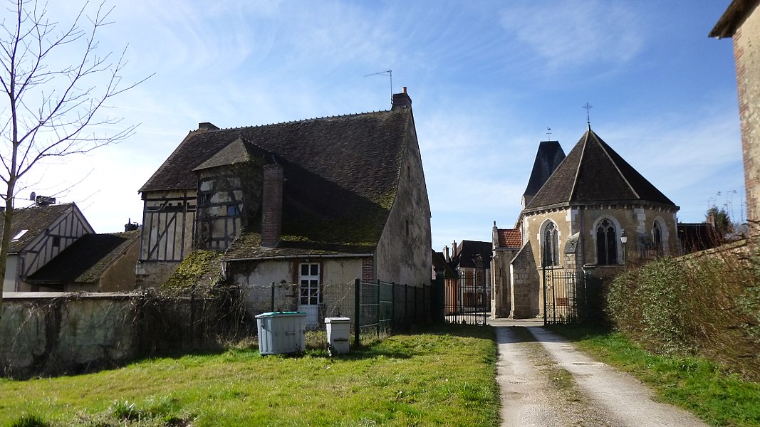 Tannerre-en-Puisaye, Yonne, Burgundy, France.  Seen from the East and from the town castle grounds (now a children holiday center), Saint-Martin church on the right. On the left, the back of the house at n° 14, Grande Rue.