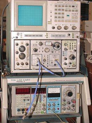 Electronic test equipment - Tektronix 7854 oscilloscope with curve tracer and time-domain reflectometer plug-ins. Lower module has a digital voltmeter, a digital counter, an old WWVB frequency standard receiver with phase comparator, and function generator.