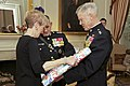 The 35th Commandant of the Marine Corps, Gen. James F. Amos, right, and Marine Corps First Lady Bonnie Amos, left, participate in a gift exchange with Gen. George J. Flynn, center, at the Home of the Commandants 130509-M-LU710-105.jpg