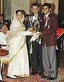 The President, Smt. Pratibha Patil presenting the Arjuna Award -2006 to Shri Subhajit Saha for Table Tennis at a glittering function, in New Delhi on August 29, 2007.jpg
