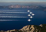 The Thunderbirds fly over Crater Lake, Oregon (29396129882).jpg