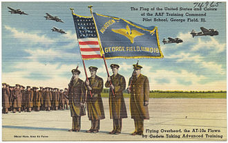 """Beechcraft AT-10 Wichita - """"The flag of the United States and colors of the AAF Training Command Pilot School, George Field, Ill, flying overhead, the AT-10s flown by cadets taking advanced training."""""""