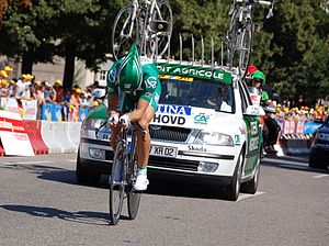 Crédit Agricole (cycling team) - Thor Hushovd riding in front of the Crédit Agricole team car, when winning the prologue in the 2006 Tour de France