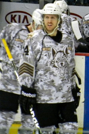 Tim Miller (ice hockey) - Miller playing for the Chicago Wolves during a military appreciation night in 2013