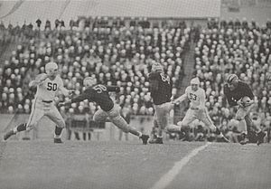 Tony Butkovich - Butkovich carrying ball behind blocking from Buscemi (50) and Kasap (64) in 1943