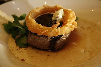 Top sirloin - Top sirloin steak, topped with an onion ring.