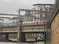 Trains crossing the Leeds and Liverpool Canal approaching Leeds railway station (14th March 2018) 001.jpg